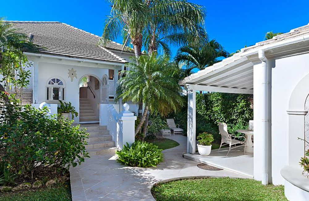 luxury 3-bed golf club villa in Barbados for sale with cottage, car and golf cart